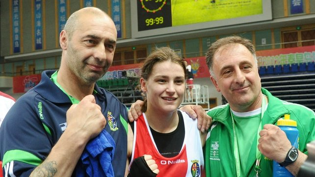 Katie Taylor celebrates with her father and coach Peter, and assistant coach Zaur Anita