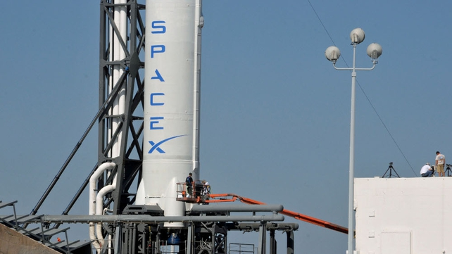 SpaceX's Falcon 9 spacecraft, with the Dragon reusable capsule, sits on the launch pad yesterday