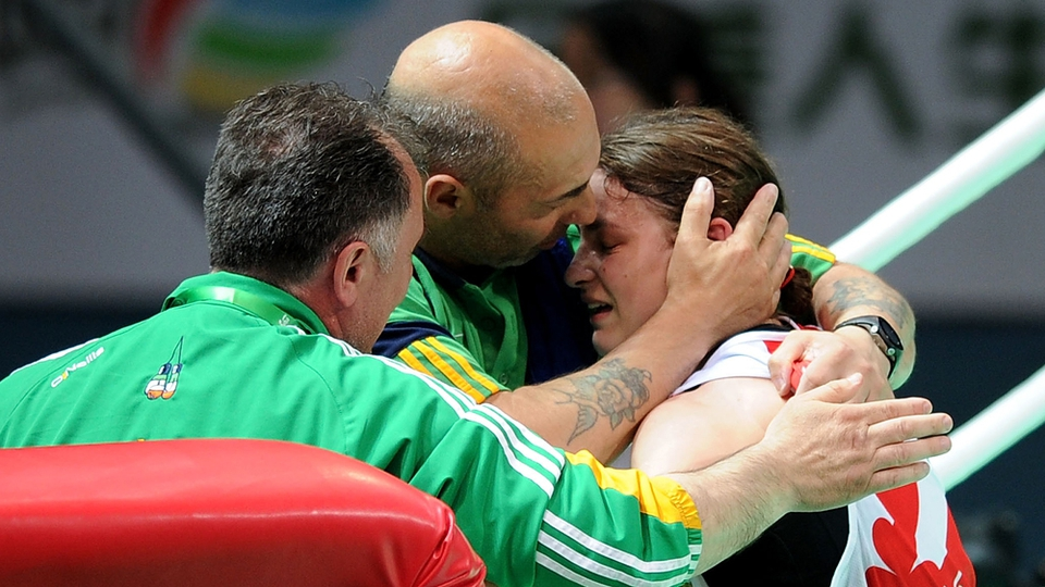 An overwhelmed Katie Taylor is congratulated by her corner