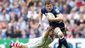 The Ireland captain gets past Darren Cave