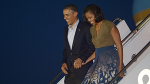 US President Barack Obama and First Lady Michelle Obama step off Air Force One upon arrival at Chicago O'Hare International Airport