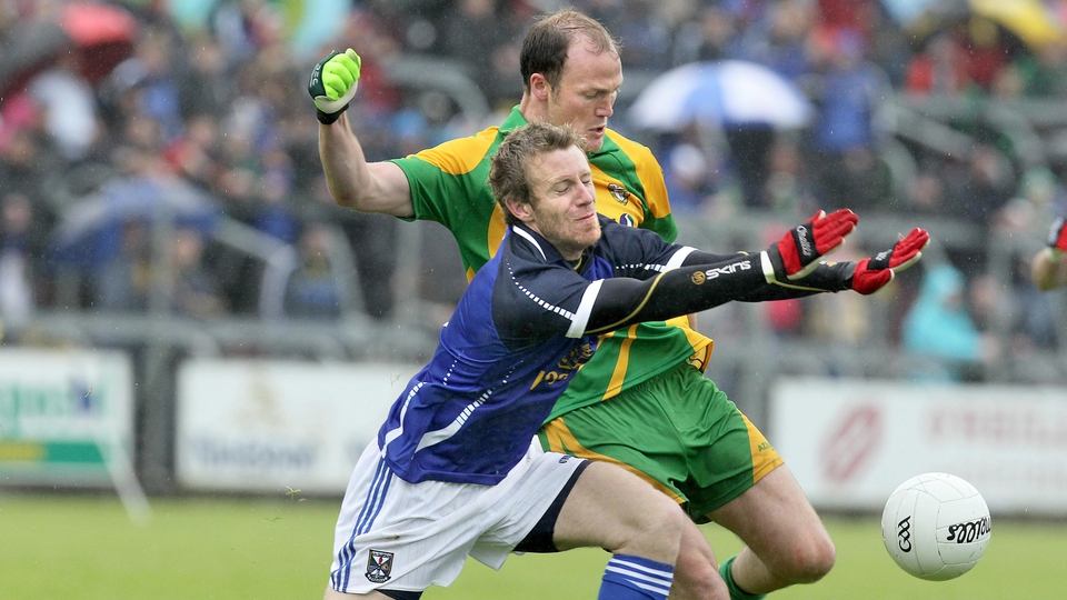Donegal's Colm McFadden tries to get his kick away under pressure from Michael Lyng of Cavan