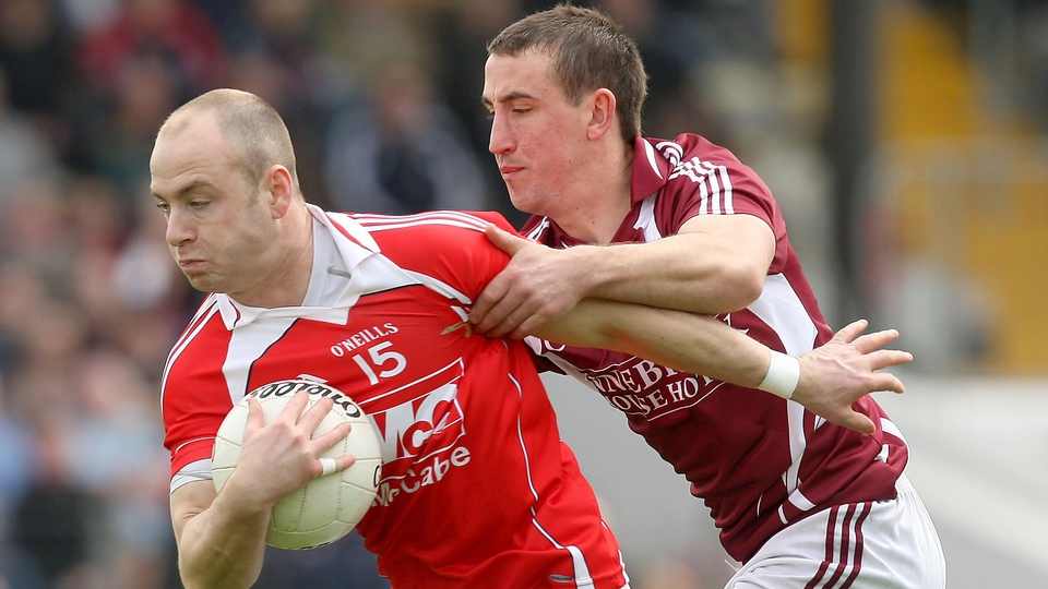 Darren Clarke of Louth escapes the clutches of Westmeath's Michael Curley