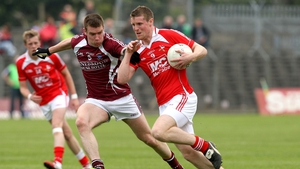 Paul Bannon of Westmeath tries to dispossess Ronan Carroll of Louth