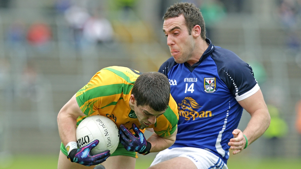 Cavan's Eugene Keating (r) with Paddy McGrath of Donegal