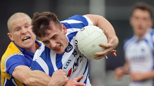 Longford's Dermot Brady tackles Gary Walsh of Laois at Pearse Park