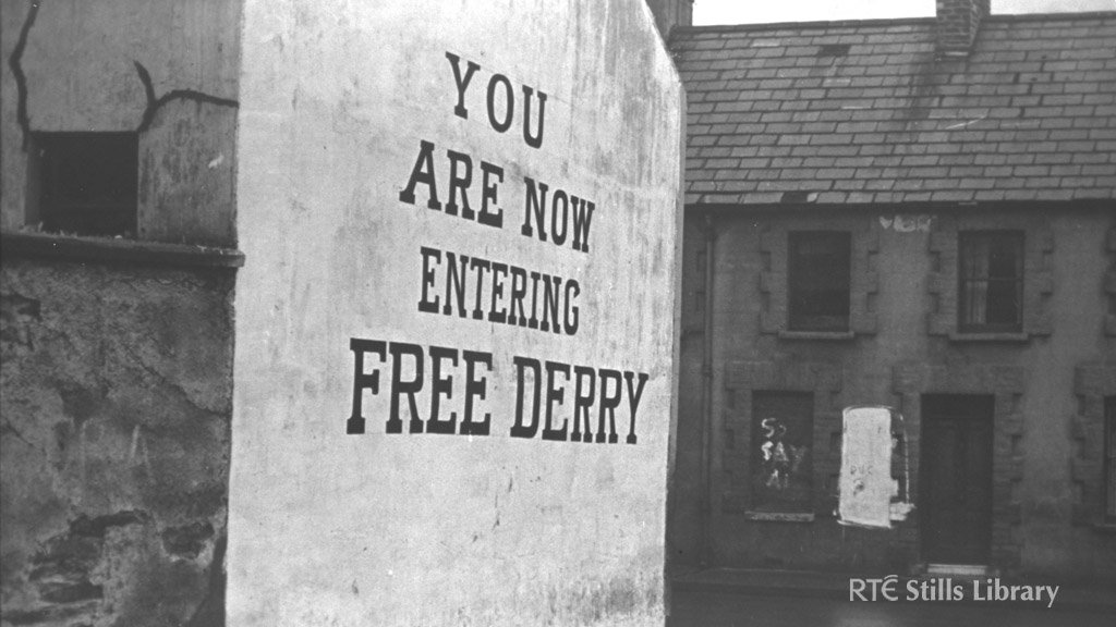 "Slogan on the gable end of a house in Derry, ""You are now entering Free Derry"".  © RTÉ Stills Library 0119/042"