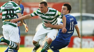 Gary O'Neill of Shamrock Rovers tries to get away from Limerick's Shane Tracy