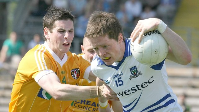 Conor McManus of Monaghan battles with Kevin O'Boyle of Antrim