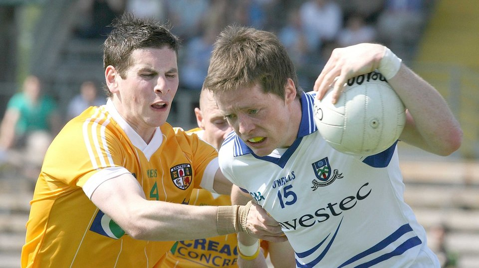 Conor McManus of Monaghan tries to get past Antrim's Kevin O'Boyle