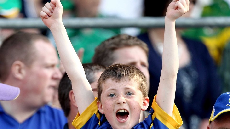 A young Tipp fan cheers his team on to victory