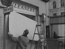 Shopkeepers in Armagh remove hoardings after civil rights demonstration.