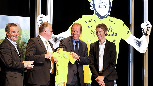 Andy Schleck (r) being presented with the 2010 Yellow Jersey in his home town of Mondorf-les-Bains on Tuesday