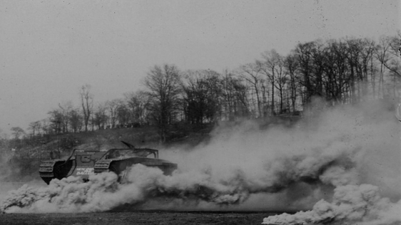 British tank moves through a smokescreen.