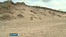 Woman dies after sand dune collapse