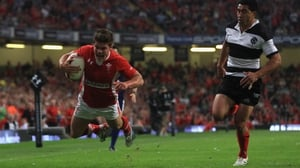 Harry Robinson of Wales crosses the line to score the opening try