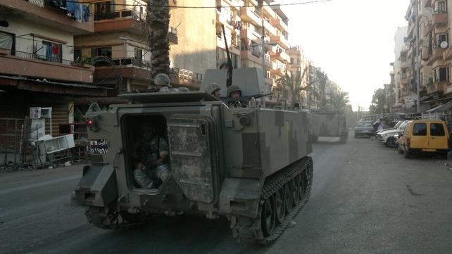 Lebanese army troops patrol the streets of Tripoli's Sunni Muslim neighbourhood of Bab al-Tabbaneh