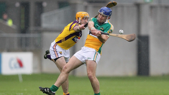 Brian Carroll comes under pressure from Wexford's David Redmond