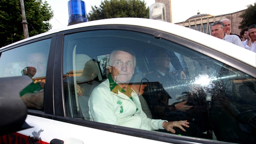 Police escort: The ever-popular Giovanni Trapattoni had to be driven away from the maddening crowd