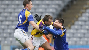 Wexford's Conor Carty is tackled by Mickey Quinn and Shane Mulligan