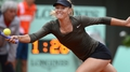 Sharapova into French Open quarters, Na out