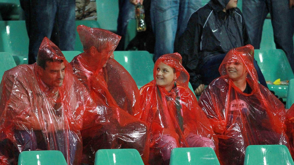 The home supporters did their best to stay dry