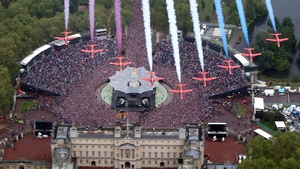 The Red Arrows fly over in formation over Buckingham Palace