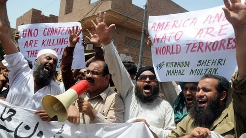 Pakistani protesters shout anti-US slogans rallying against US drone attacks in the Pakistani tribal belts during a demonstration in Multan yesterday