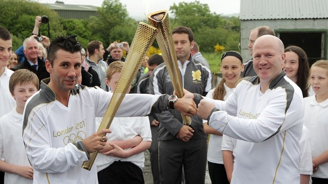 Olympic medallists Wayne McCullough (l) and Michael Carruth with the flame near Newry
