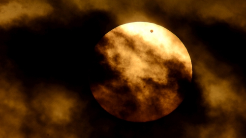 The transit of Venus between the Earth and sun as seen from Rome, Italy