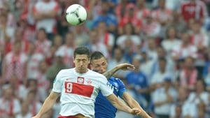 Robert Lewandowski rises highest in the  Poland v Greece clash