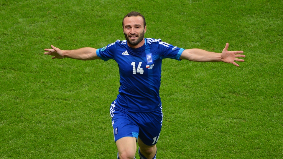 Dimitris Salpingidis gave Greece a share of the spoils with his equaliser