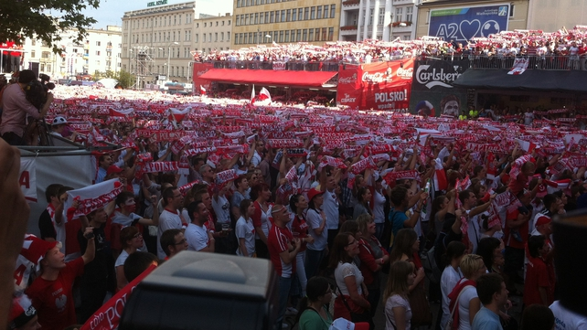 Polish fans in Poznan watch on as their side drew 1-1 with Greece in the opening match of Euro 2012