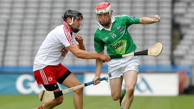 Tyrone's Paul McGoldrick battles with Fermanagh's Mike O'Gorman