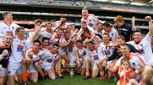 The Armagh squad celebrate with the Nicky Rackard trophy