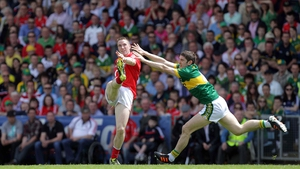 Cork's Colm O'Neill gets a shot in despite the efforts of Kerry's Killian Young