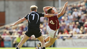 Sligo's Paul McGovern tackles Paul Conroy of Galway