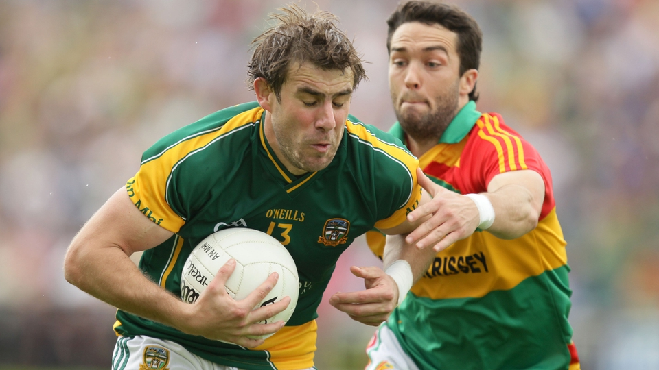 Brian Farrell of Meath is tackled by Carlow's Brian Kavanagh
