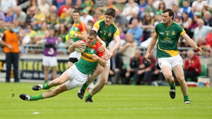 Carlow's Brendan Murphy is tackled by Conor Gillespie of Meath