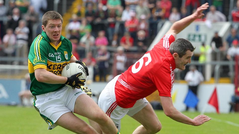 Kieran O'Leary swivels past Graham Canty