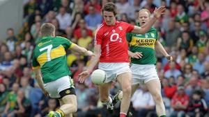 Cork's Aidan Walsh and Kerry's Peter Crowley and Seamus Scanlon