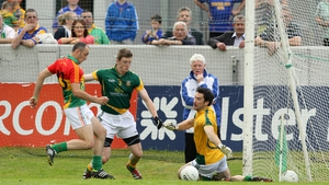Carlow's JJ Smith scores a late goal past Meath goalkeeper David Gallagher to draw the match