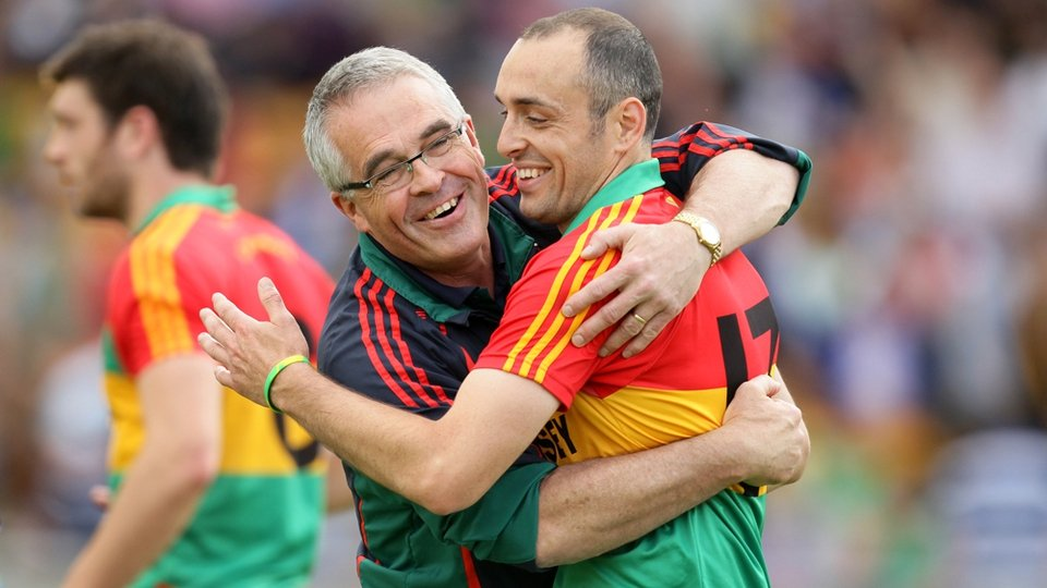 Carlow manager Luke Dempsey celebrates with goalscorer JJ Smith after the game