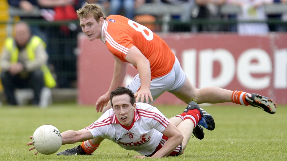 Armagh's Kieran Toner and Tyrone's Colm Cavannagh