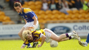 Longford's Colm Smyth tackles Ben Brosnan of Wexford