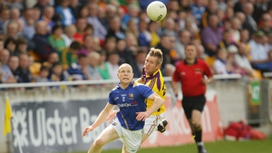 Clash of the hairstyles. Longford's Dermot Brady and PJ Banville of Wexford