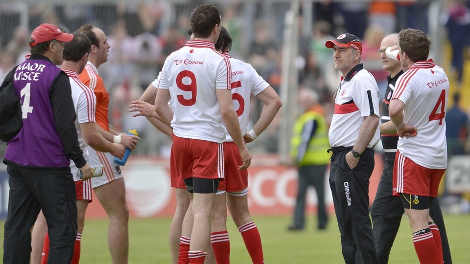 Tyrone manager Mickey Harte speaks to his players