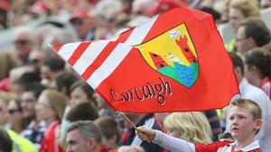 A young Cork fan flies his flag