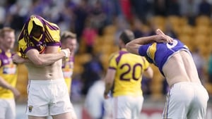 Longford's Bernard McElvaney and Daithi Waters of Wexford swap jerseys after the game