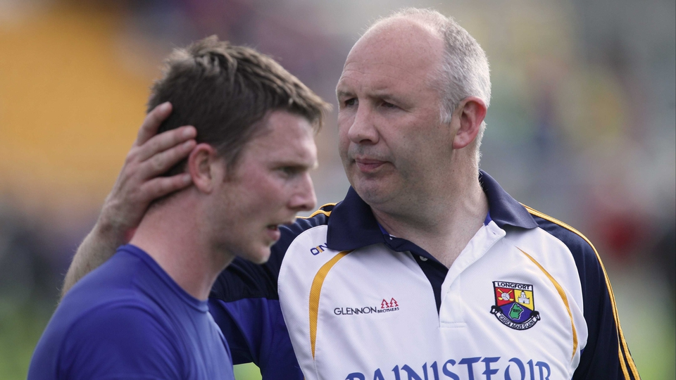 Longford manager Glenn Ryan consoles Sean McCormack after defeat in Tullamore